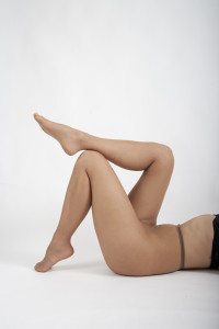 Professional model Melissa in Act IV Suntan. Notice the run on the inside of her right thigh.